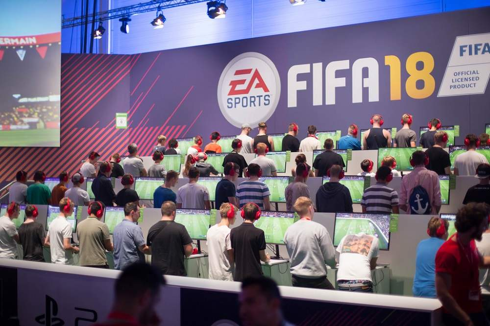 A group of eSports players play FIFA in a tournament in Cologne (Credit: Marco Verch/Flickr)